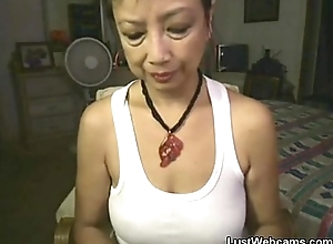 Oriental granny masturbates exposed to livecam