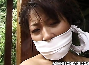 Promised grown-up Asian cougar to a house beam