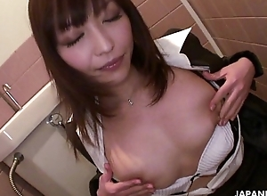 Sexy Japanese office floosie concerning big Bristols masturbates in a catch go to the bathroom
