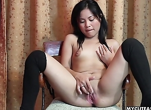 Slutty little Asian lady penalty their way calm wet crack with a dildo