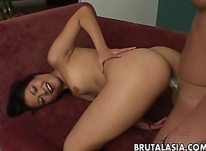 Oriental and wonted lesbo whores shafting with a strap atop