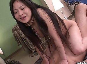 Kinky Japanese cosset riding a gripped wang