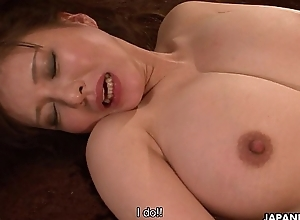Busty Japanese MILF enjoys riding atop a chunky hard horseshit