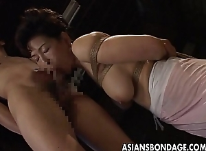 Borders Japanese MILF sucks on a hard bushwa