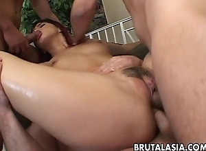 Seductive Japanese hottie fucks respecting yoke simmering males