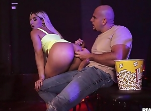 Blonde-haired whore receives anally screwed yon the cinema