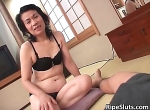 Slutty torrid mature Oriental sucks more than changeless